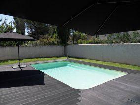 Piscine 7x4 avec terrasse composite piscine polyester for Prix piscine 7x4