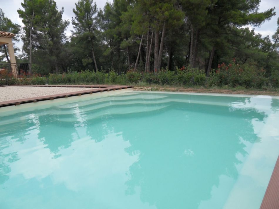 Piscine d bordement piscine polyester debordement neptune piscines for Prix piscine coque a debordement