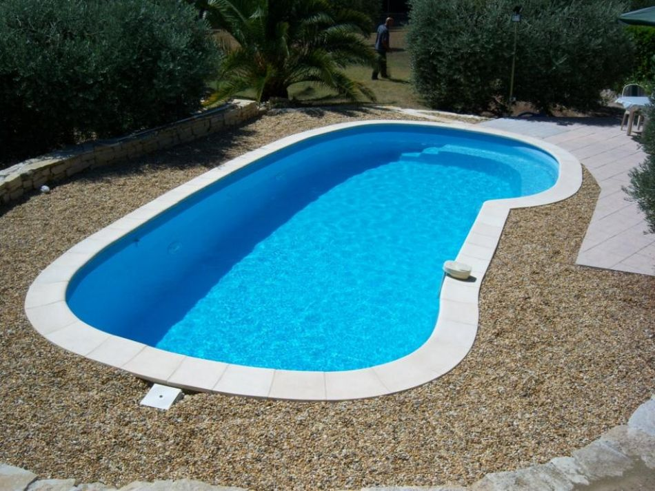 Piscine aux formes naturelles piscine lagon neptune for Prix piscine lagon